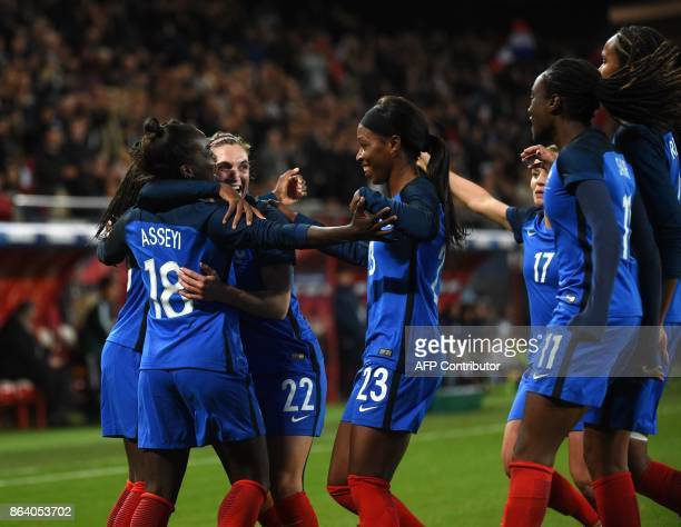 rance's Viviane Asseyi celebrates with her teammates after scoring during the friendly football match between France and England at the Hainaut...