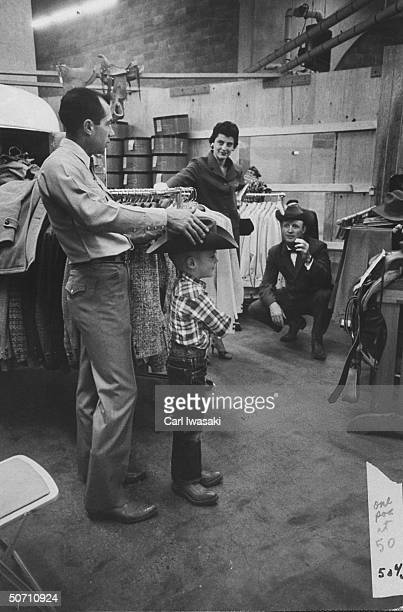 Ranch family shopping for a 5gallon hat for their 4 year old son during the stock show