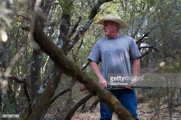 Rancher Rob Brown scourers parts of his 300 acre property for illegal marijuana plants and growers on August 6 2014 in Kelseyville California...