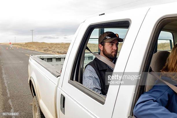 Rancher Tucker Dunbar sits in the cab of his family ranch truck at a checkpoint near the Malheur Wildlife Refuge near Burns Oregon on January 29 2016...