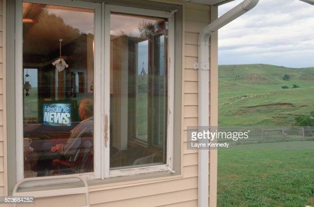 rancher watching headline news - television show stock pictures, royalty-free photos & images
