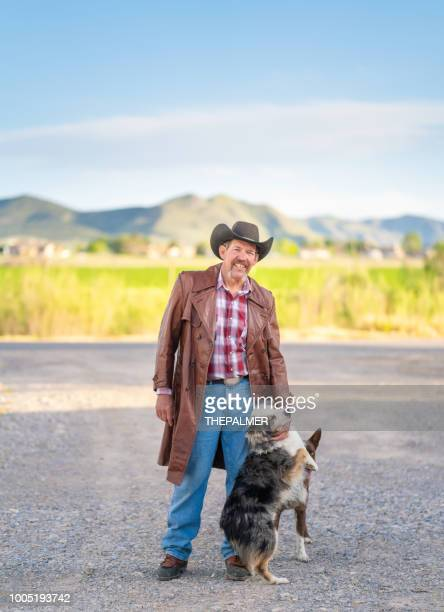 rancher with his dogs - ranch stock pictures, royalty-free photos & images