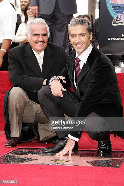 Ranchera singer Vicente Fernandez poses with his son Alejandro Fernandez who is honored with a Star On The Walk Of Fame on December 2 2005 in Los...