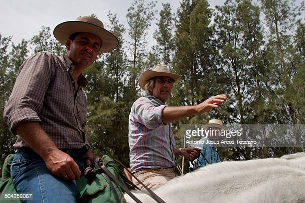 """Ranchers riding horses in their way from Doñana to Almonte during the """"Out of the mares"""" . As known, """"Out of the mares"""" is a tradition that goes back..."""