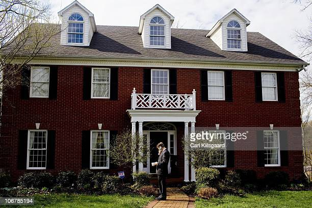 Rand Paul waits in front of his home for the rest of his family to come outside so they can go to church on March 28 2010 in Bowling Green Kentucky...