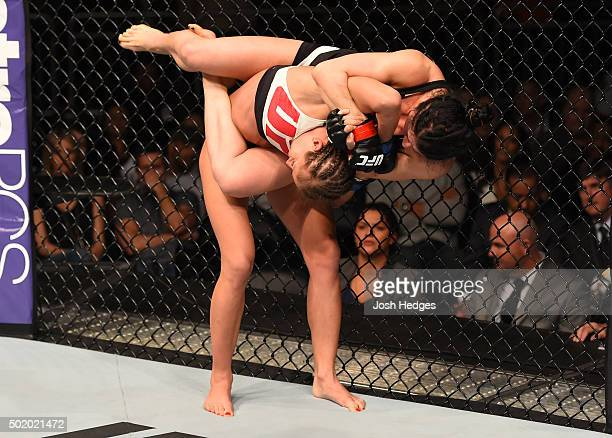 Randa Markos attempts to submit Karolina Kowalkiewicz in their women's strawweight bout during the UFC Fight Night event at the Amway Center on...