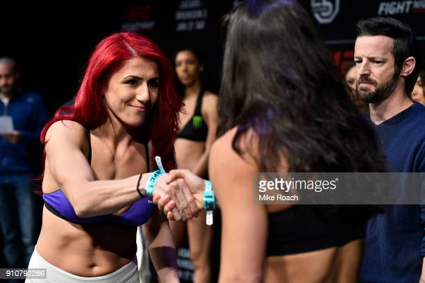 Randa Markos of Iraq and Juliana Lima shake hands during a UFC Fight Night weighin on January 26 2018 in Charlotte North Carolina