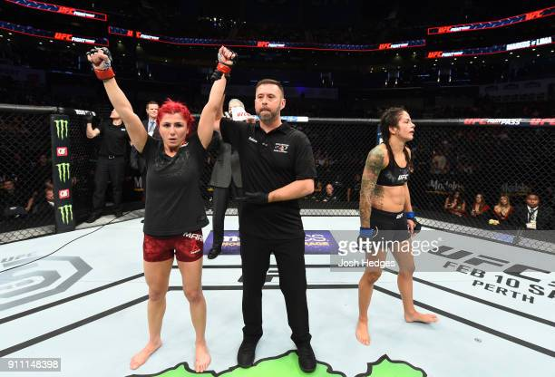 Randa Markos of Iraq celebrates her victory over Juliana Lima of Brazil in their women's strawweight bout during a UFC Fight Night event at Spectrum...
