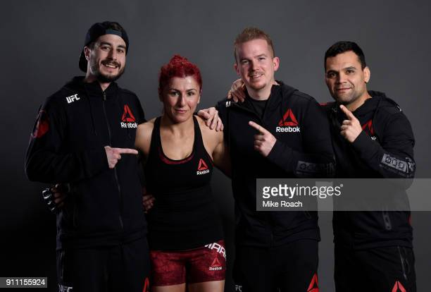 Randa Markos of Iraq poses for a post fight portraits with her team backstage during a UFC Fight Night event at Spectrum Center on January 27 2018 in...
