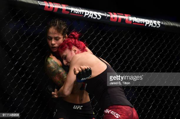 Randa Markos of Iraq presses Juliana Lima of Brazil in their strawweight bout during the UFC Fight Night event inside the Spectrum Center on January...