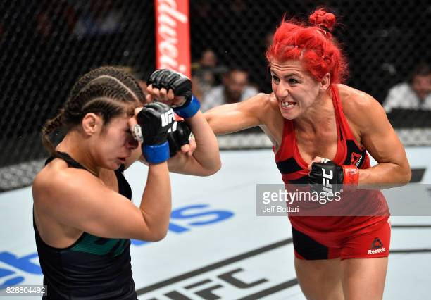 Randa Markos of Iraq punches Alexa Grasso of Mexico in their women's strawweight bout during the UFC Fight Night event at Arena Ciudad de Mexico on...