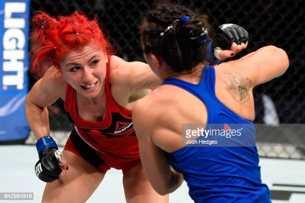 Randa Markos of Iraq punches Carla Esparza in their women's strawweight fight during the UFC Fight Night event inside the Scotiabank Centre on...
