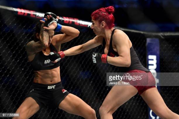 Randa Markos of Iraq punches Juliana Lima of Brazil in their strawweight bout during the UFC Fight Night event inside the Spectrum Center on January...