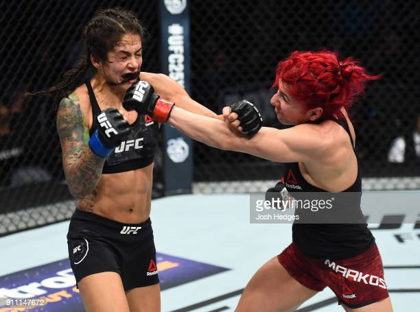 Randa Markos of Iraq punches Juliana Lima of Brazil in their women's strawweight bout during a UFC Fight Night event at Spectrum Center on January 27...
