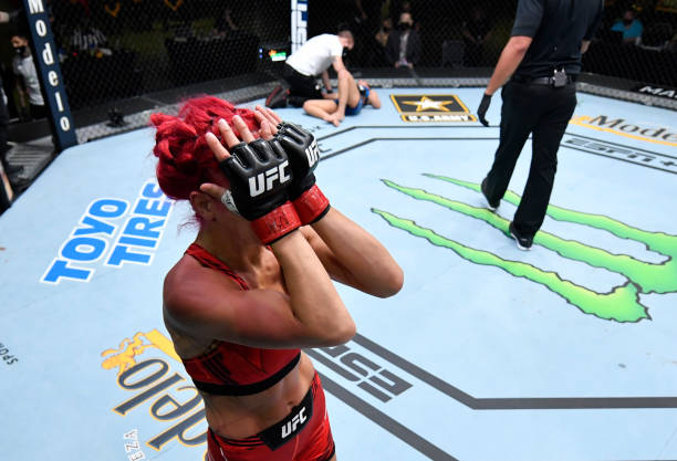 Randa Markos of Iraq reacts after her fight against Luana Pinheiro of Brazil was stopped due to her illegal kick during the UFC Fight Night event at...