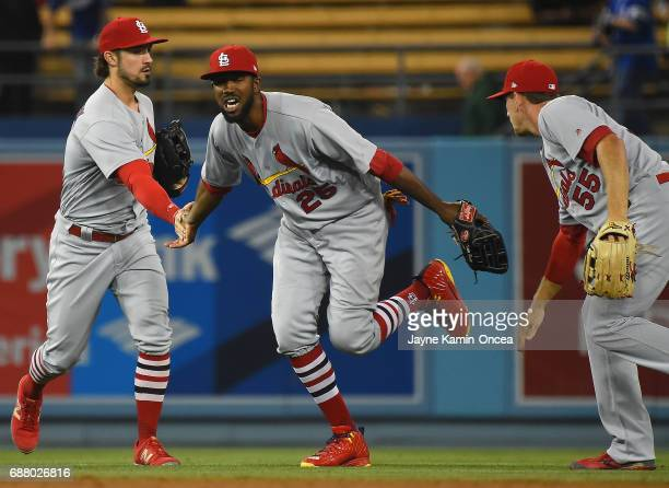 Randal Grichuk Dexter Fowler and Stephen Piscotty of the St Louis Cardinals run off the field after defeating the Los Angeles Dodgers at Dodger...
