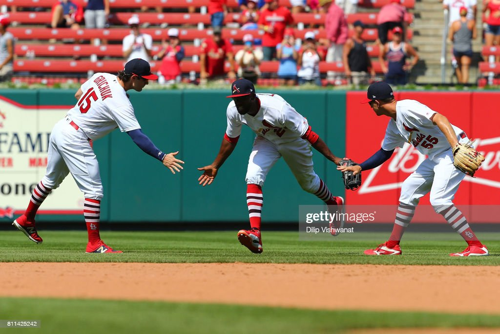 Randal Grichuk #15, Dexter Fowler #25 and Stephen Piscotty #55 of the St. Louis Cardinals celebrate after beating the New York Mets at Busch Stadium on July 9, 2017 in St. Louis, Missouri.