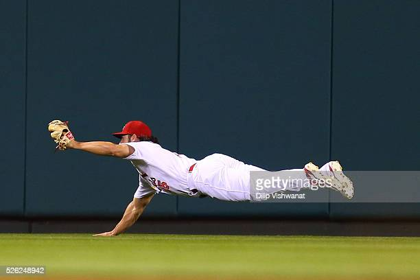 Randal Grichuk of the St Louis Cardinals catches a fly ball against the Washington Nationals in the seventh inning at Busch Stadium on April 29 2016...