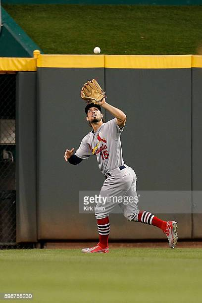 Randal Grichuk of the St Louis Cardinals catches a fly ball hit by Tucker Barnhart of the Cincinnati Reds during the fourth inning at Great American...
