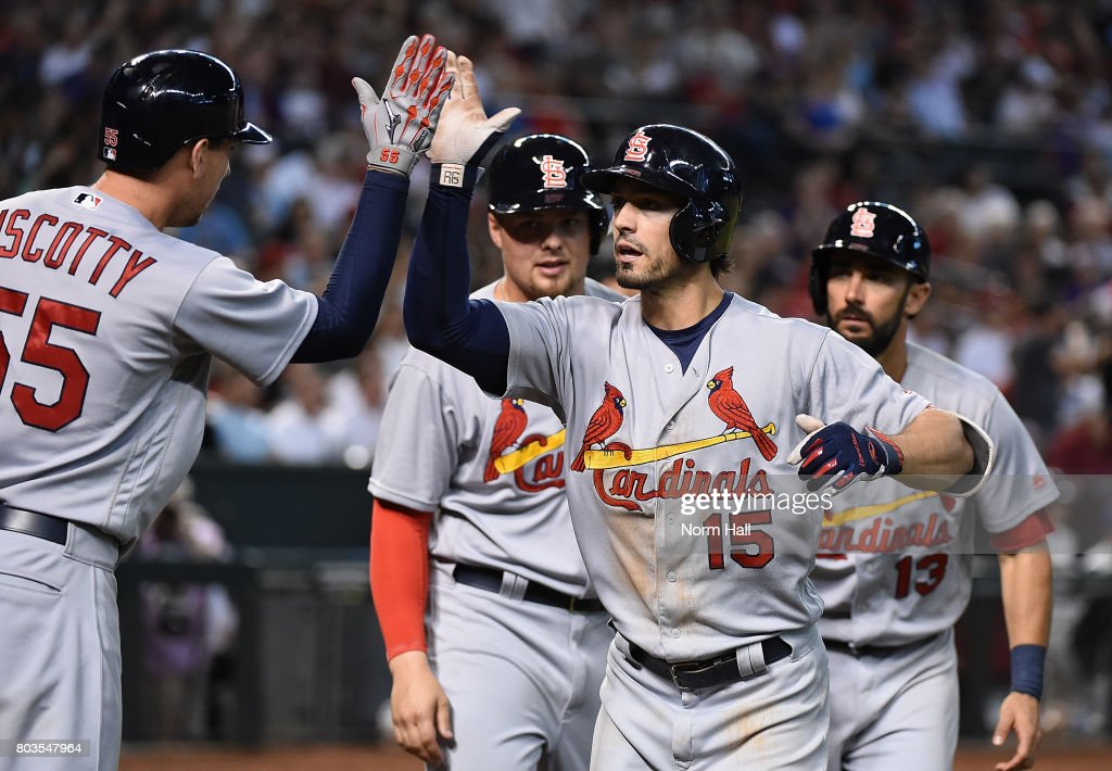 Randal Grichuk #15 of the St Louis Cardinals celebrates with teammates Matt Carpenter #13, Luke Voit #40 and Stephen Piscotty #55 after hitting a three run home run off of Ruby De La Rosa #12 of the Arizona Diamondbacks during the seventh inning at Chase Field on June 29, 2017 in Phoenix, Arizona.