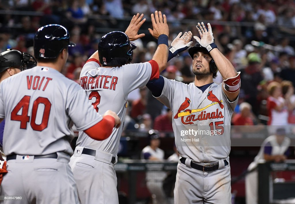 Randal Grichuk #15 of the St Louis Cardinals celebrates with teammates Matt Carpenter #13 and Luke Voit #40 after hitting a three run home run off of Ruby De La Rosa #12 of the Arizona Diamondbacks during the seventh inning at Chase Field on June 29, 2017 in Phoenix, Arizona.