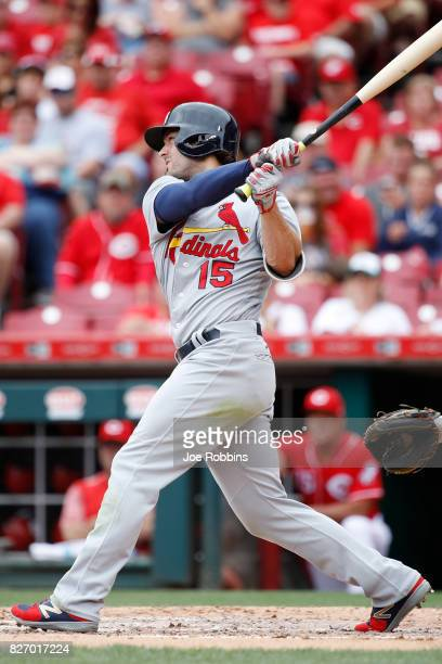Randal Grichuk of the St Louis Cardinals doubles to drive in two runs in the second inning of a game against the Cincinnati Reds at Great American...