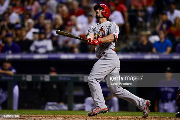 Randal Grichuk of the St Louis Cardinals follows the flight of a third inning tworun homerun hits off of Tyler Anderson of the Colorado Rockies...