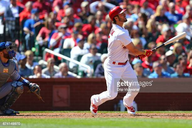 Randal Grichuk of the St Louis Cardinals hits a gametying solo home run against the Toronto Blue Jays in the ninth inning at Busch Stadium on April...