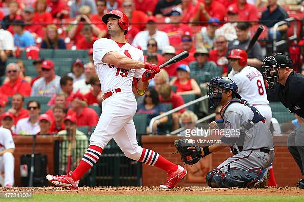 Randal Grichuk of the St Louis Cardinals hits a sacrifice RBI against the Minnesota Twins in the second inning at Busch Stadium on June 16 2015 in St...