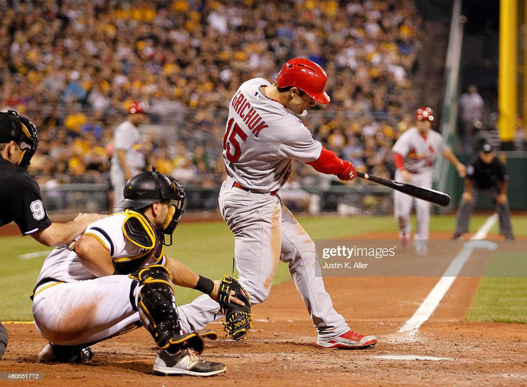 Randal Grichuk #15 of the St. Louis Cardinals hits a two RBI double in the tenth inning during the game against the Pittsburgh Pirates at PNC Park on July 12, 2015 in Pittsburgh, Pennsylvania.