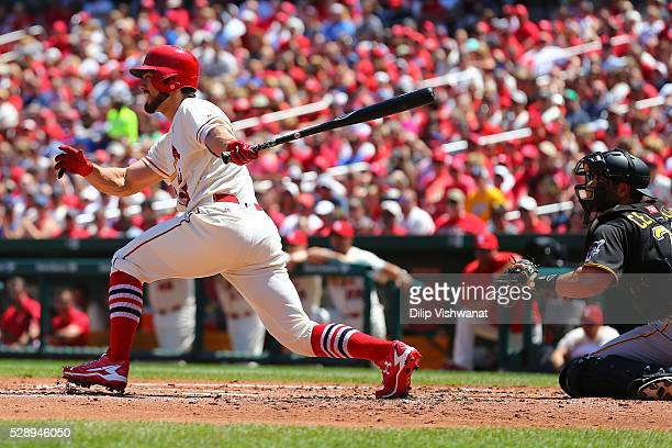Randal Grichuk of the St Louis Cardinals hits a twoRBI single against the Pittsburgh Pirates in the first inning at Busch Stadium on May 7 2016 in St...