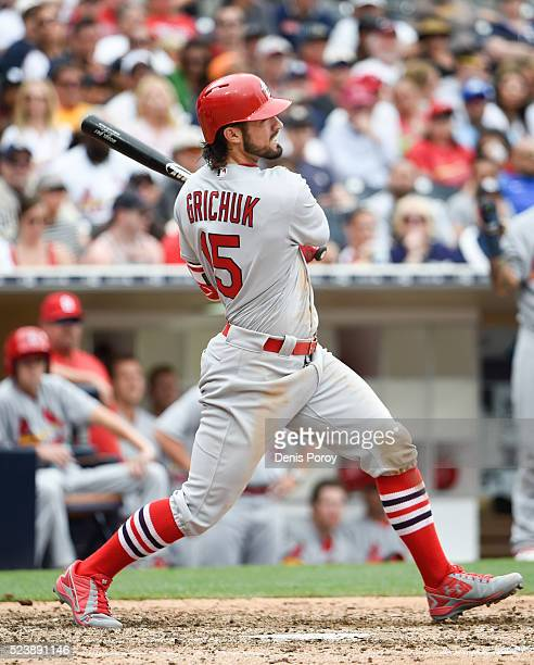 Randal Grichuk of the St Louis Cardinals hits an RBI double during the eighth inning of a baseball game against the San Diego Padres at PETCO Park on...