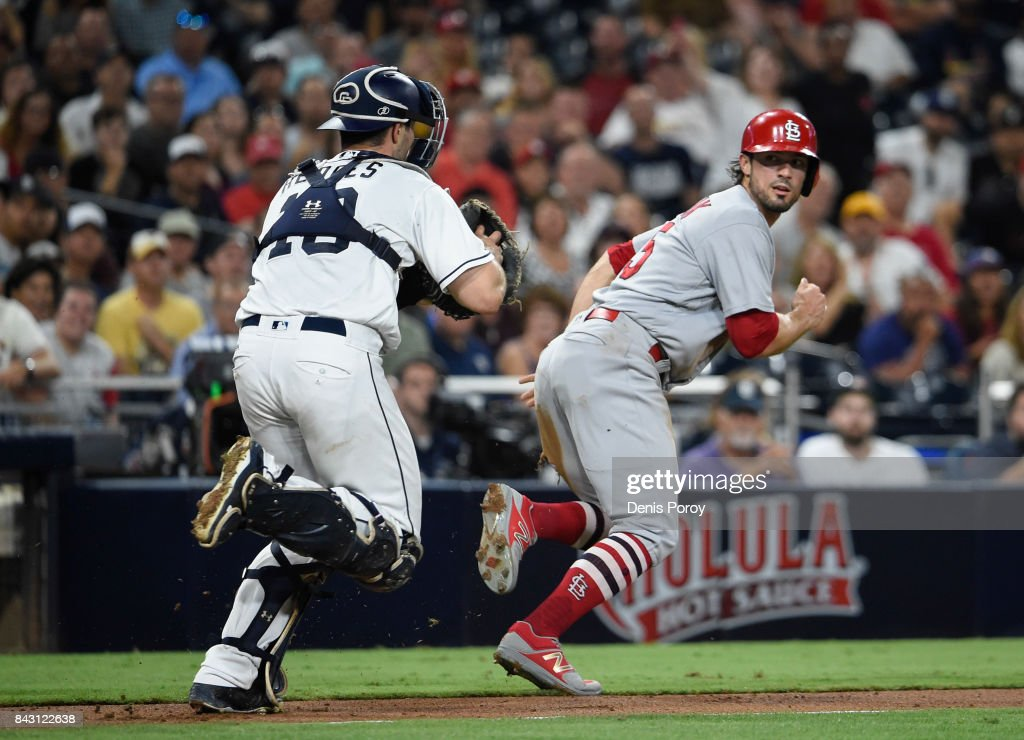 Randal Grichuk #15 of the St. Louis Cardinals is chased by Austin Hedges #18 of the San Diego Padres in a run down during the fourth inning of a baseball game at PETCO Park on September 5, 2017 in San Diego, California. Grichuk was tagged out on the play.
