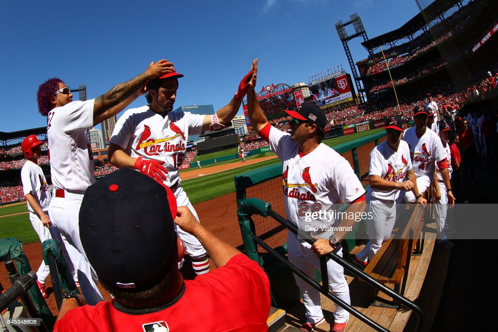 Randal Grichuk #15 of the St. Louis Cardinals is congratulated by manager Mike Matheny #22 and Carlos Martinez #18 of the St. Louis Cardinals after hitting a home run against the Pittsburgh Pirates in the fourth inning at Busch Stadium on September 10, 2017 in St. Louis, Missouri.