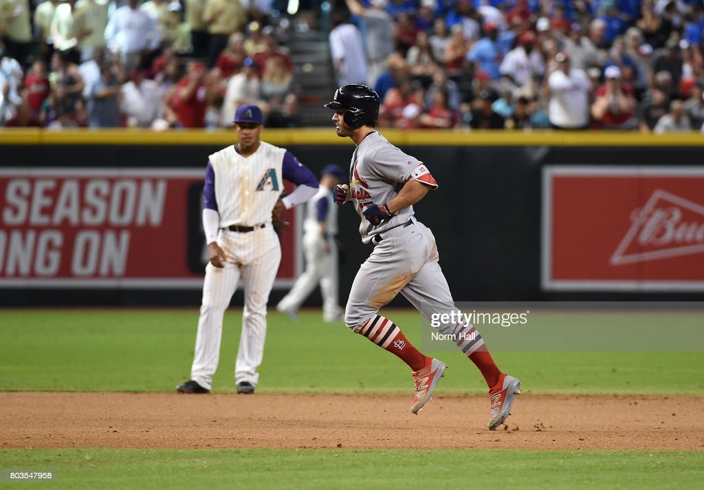 Randal Grichuk #15 of the St Louis Cardinals rounds the bases after hitting a three run home run off of Ruby De La Rosa #12 of the Arizona Diamondbacks during the seventh inning at Chase Field on June 29, 2017 in Phoenix, Arizona.