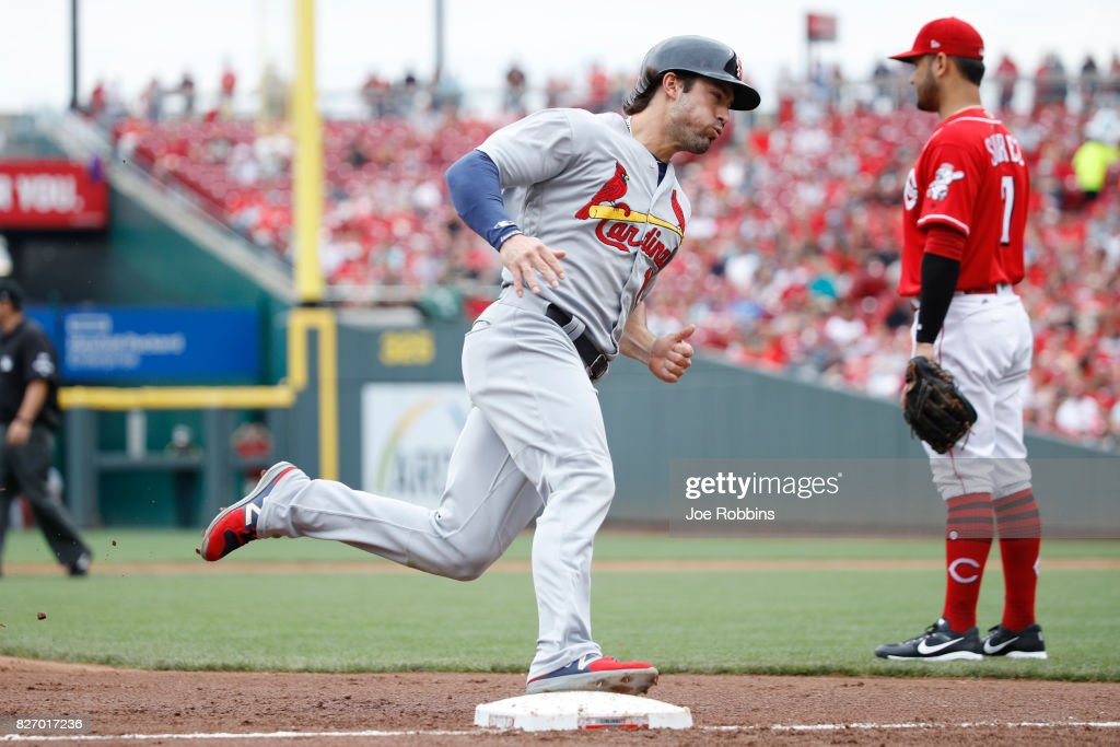 Randal Grichuk #15 of the St. Louis Cardinals runs around third base on his way to scoring after a double by Greg Garcia in the second inning of a game against the Cincinnati Reds at Great American Ball Park on August 6, 2017 in Cincinnati, Ohio.
