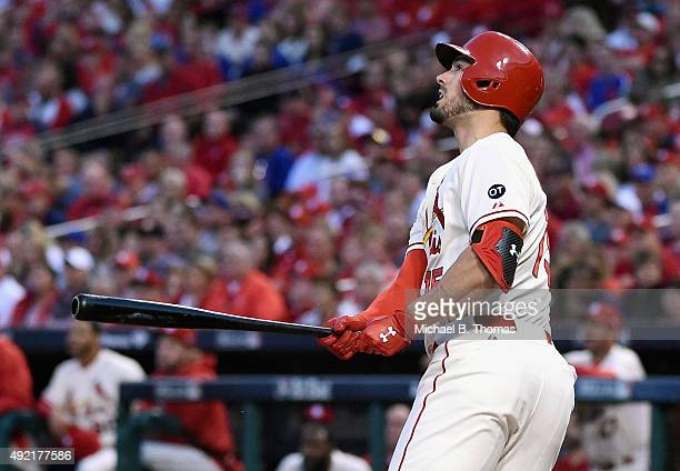 Randal Grichuk of the St Louis Cardinals watches his solo home run in the fifth inning against the Chicago Cubs during game two of the National...