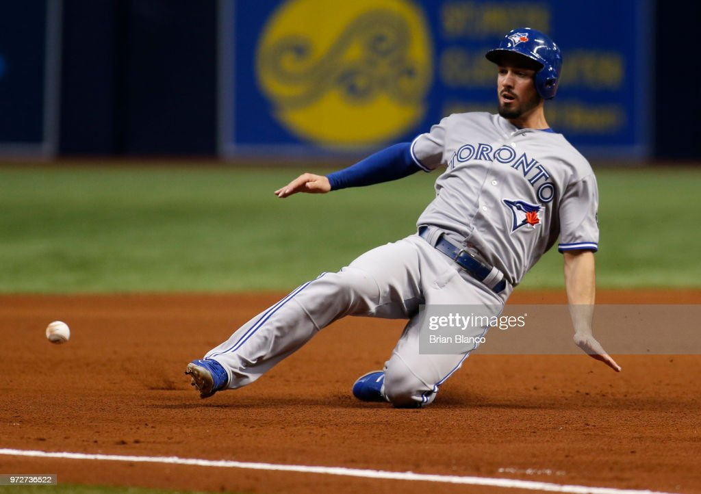 Randal Grichuk #15 of the Toronto Blue Jays advances to third base from first base off of the single by Aledmys Diaz during the fifth inning of a game against the Tampa Bay Rays on June 12, 2018 at Tropicana Field in St. Petersburg, Florida.