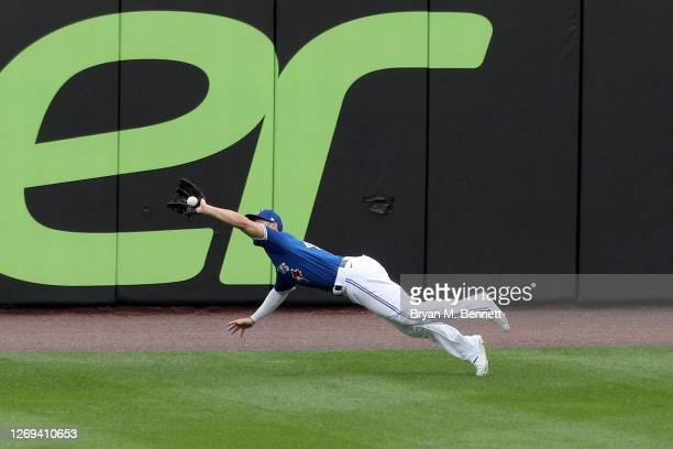 Randal Grichuk of the Toronto Blue Jays catches a flyball hit by Anthony Santander of the Baltimore Orioles during the first inning at Sahlen Field...