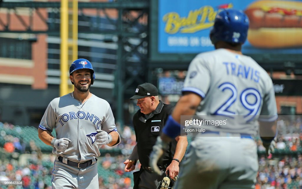 Randal Grichuk #15 of the Toronto Blue Jays celebrates a two run home run with teammate Devon Travis #29 during the eight inning of the game against the Detroit Tigers Comerica Park on June 3, 2018 in Detroit, Michigan.
