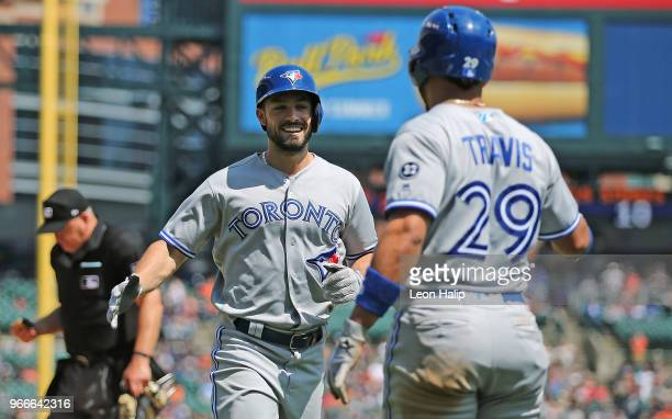 Randal Grichuk of the Toronto Blue Jays celebrates a two run home run with teammate Devon Travis during the eight inning of the game against the...