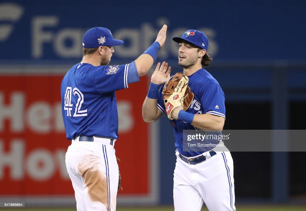 Randal Grichuk #15 of the Toronto Blue Jays celebrates their victory with Justin Smoak #14 during MLB game action against the Kansas City Royals at Rogers Centre on April 17, 2018 in Toronto, Canada.