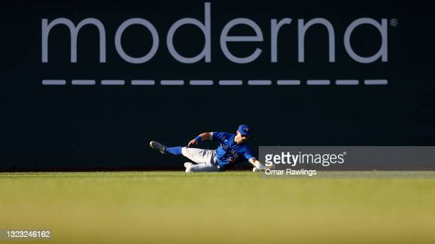 Randal Grichuk of the Toronto Blue Jays drops a line drive in the bottom of the sixth inning of the game against the Boston Red Sox at Fenway Park on...