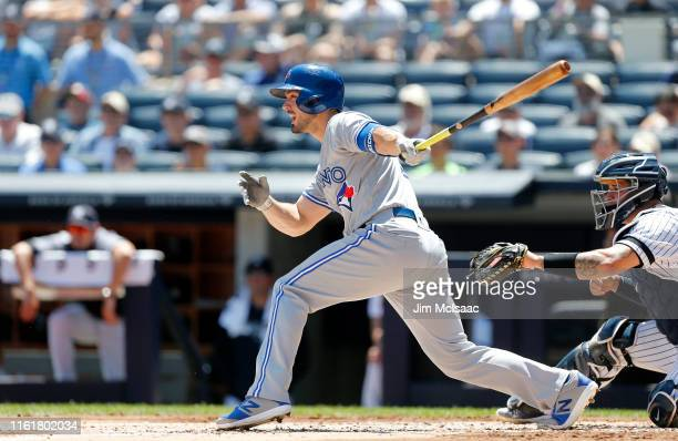 Randal Grichuk of the Toronto Blue Jays follows through on a second inning infield single against the New York Yankees at Yankee Stadium on July 13,...