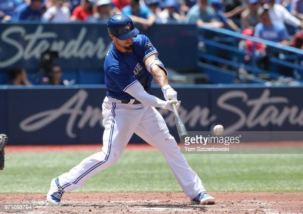 Randal Grichuk of the Toronto Blue Jays hits a single in the fourth inning during MLB game action against the Baltimore Orioles at Rogers Centre on...