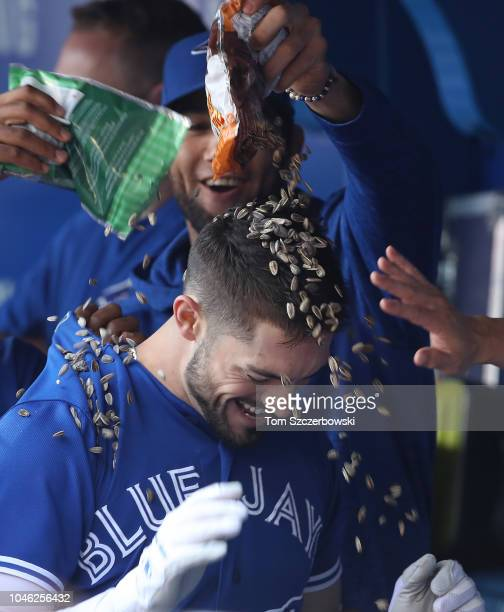 Randal Grichuk of the Toronto Blue Jays is congratulated by teammates in the dugout after hitting a tworun home run in the first inning during MLB...