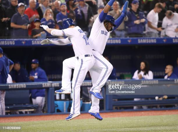 Randal Grichuk of the Toronto Blue Jays is congratulated by Vladimir Guerrero Jr #27 after hitting a tworun home run in the first inning during MLB...