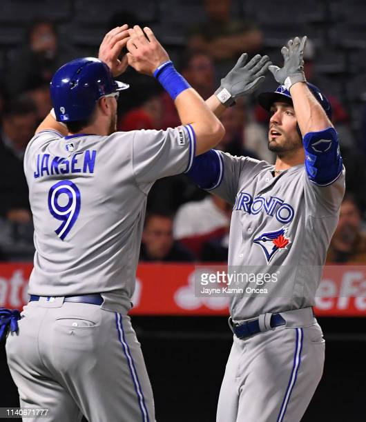 Randal Grichuk of the Toronto Blue Jays is greeted at the plate by Danny Jansen after hitting a two run home run in the sixth inning of the game...