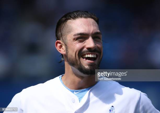 Randal Grichuk of the Toronto Blue Jays laughs during MLB game action against the Washington Nationals at Rogers Centre on June 17 2018 in Toronto...