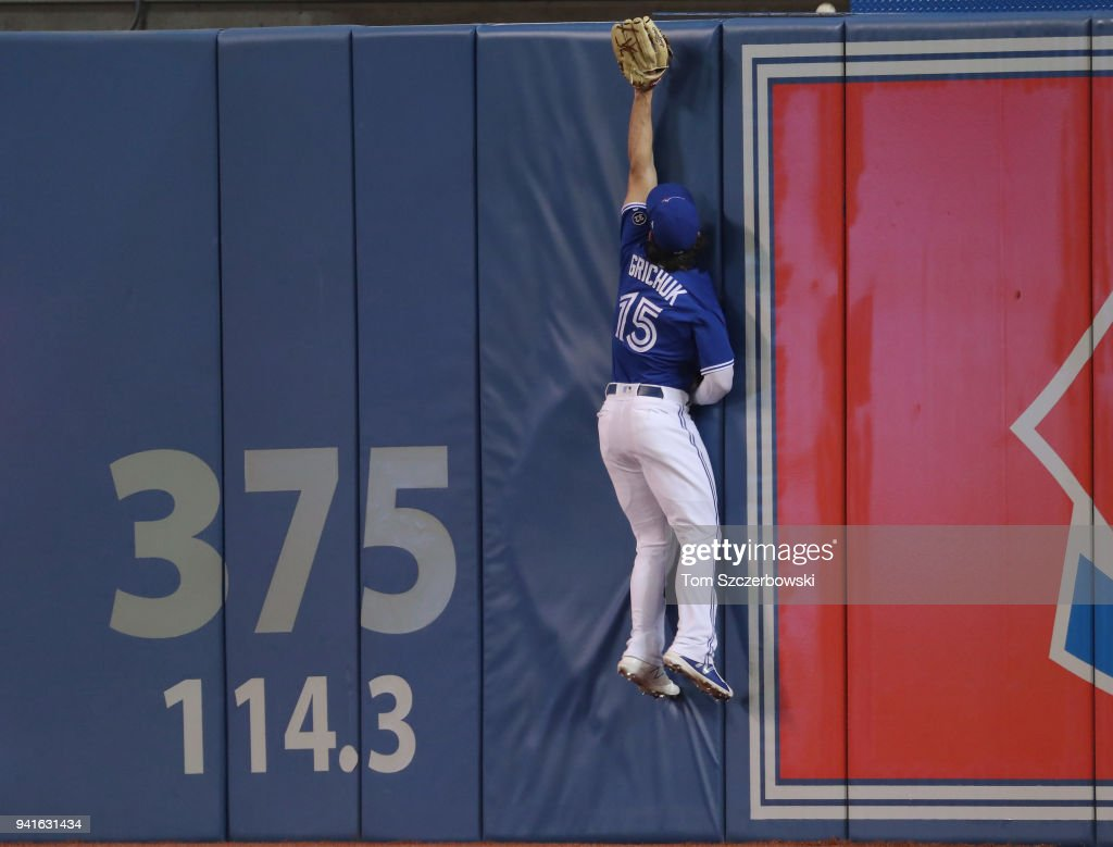 Randal Grichuk #15 of the Toronto Blue Jays leaps against the wall but cannot get to a solo home run hit by Tim Anderson #7 of the Chicago White Sox in the fourth inning during MLB game action at Rogers Centre on April 3, 2018 in Toronto, Canada.